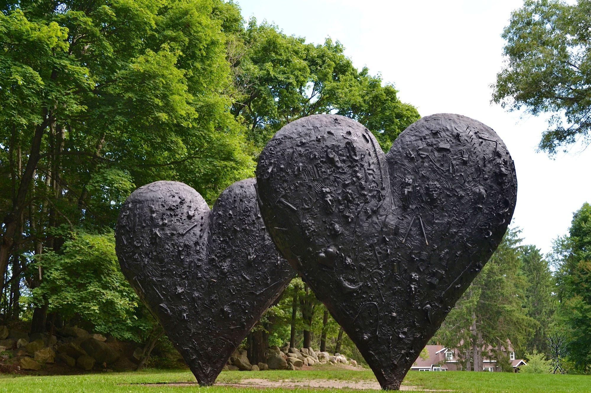 two large black hearts with trees in the background