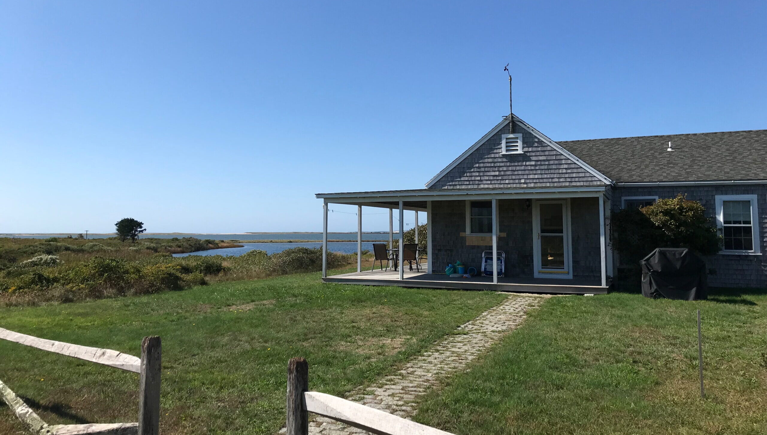 Long Point Beach Cottage, with view of water in the background, scaled
