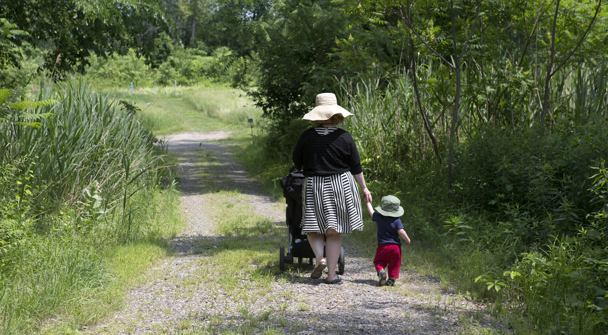 Woman walking with young child