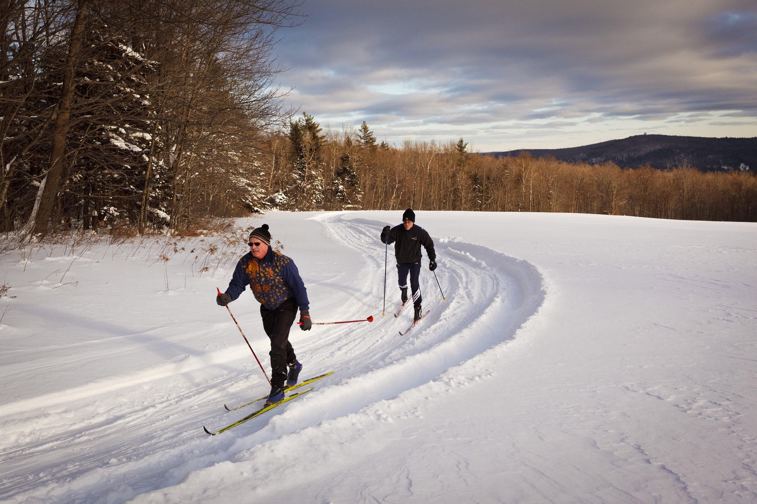 Two men cross country skiing at the Notchview