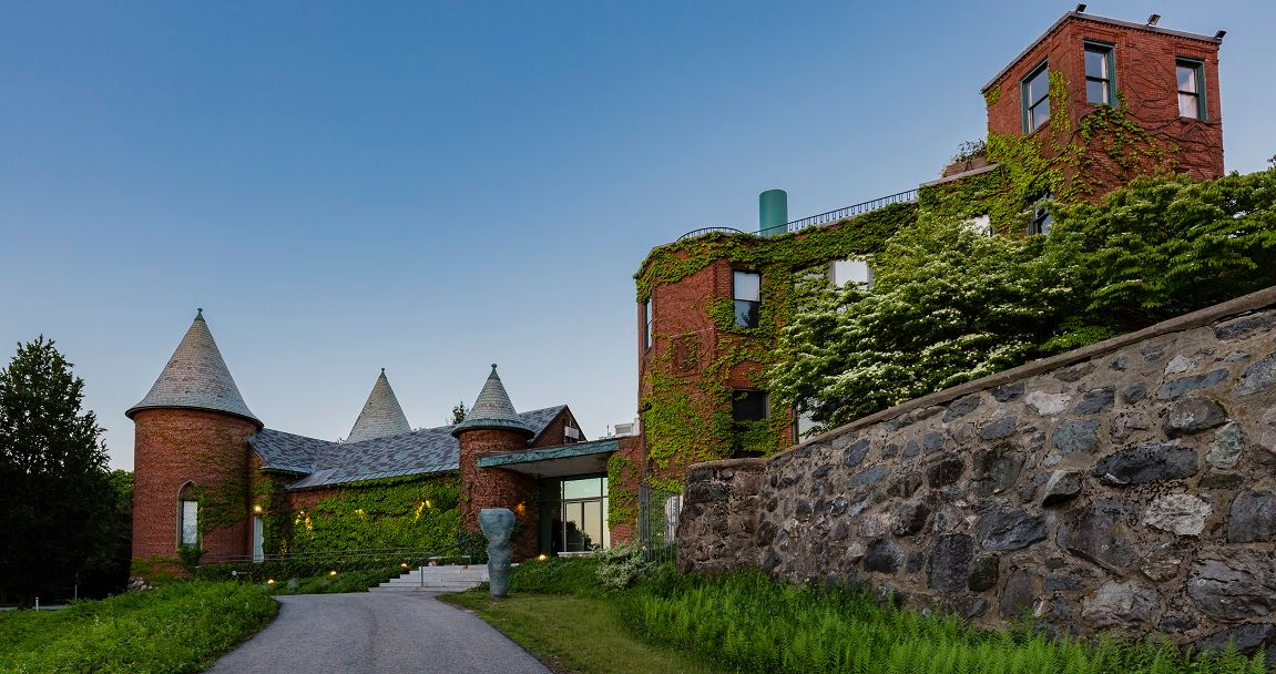 the brick back side of deCordova with ivy and turrets