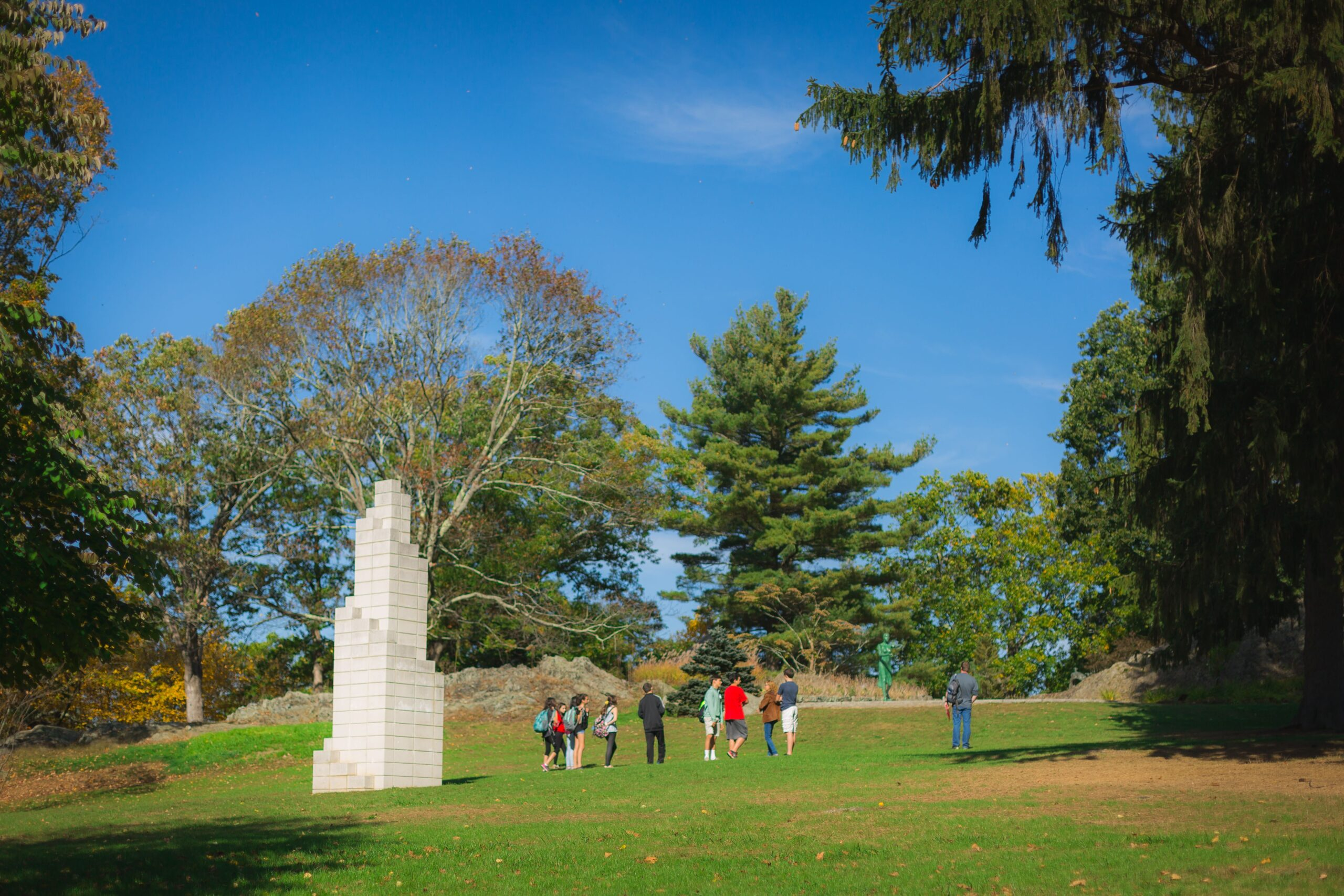 guests enjoy the Sol LeWitt statue on the grounds of deCordova