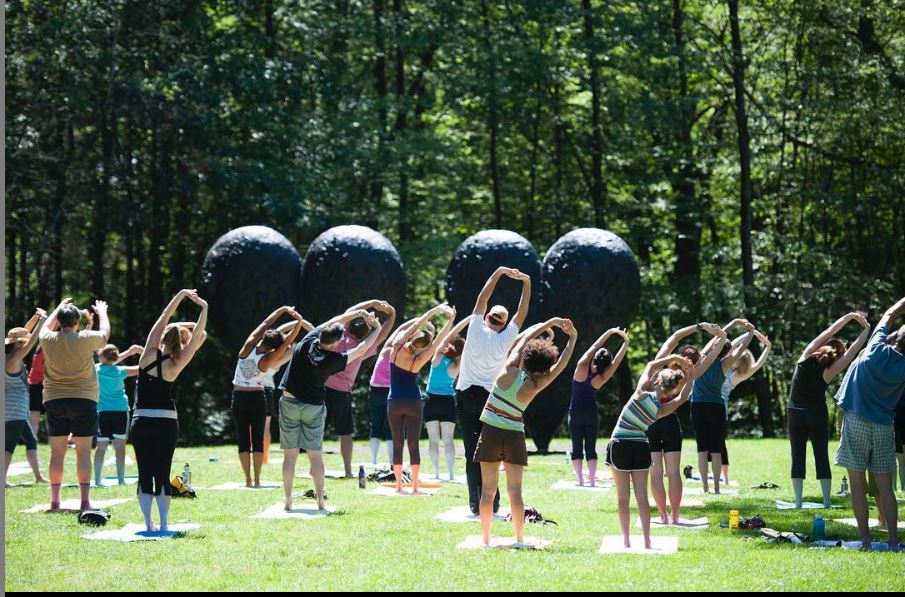yoga in front of big black hearts