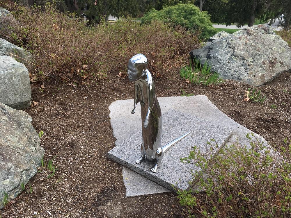 a shiny human like statue of an otter