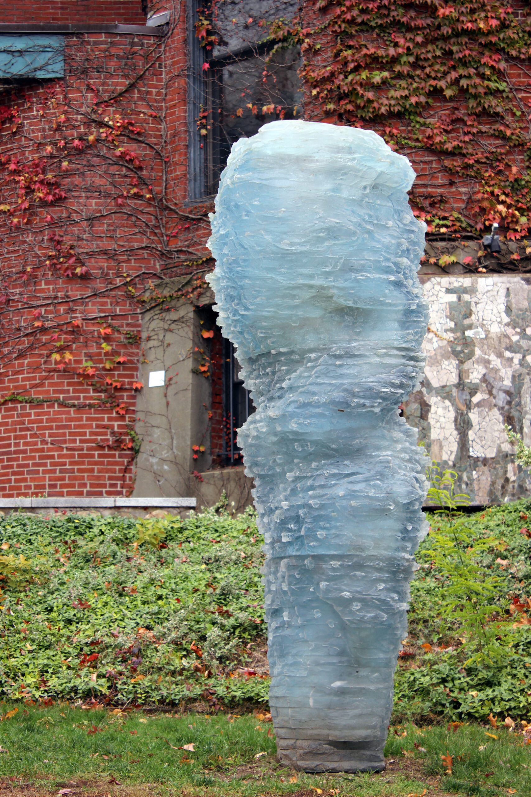 a clear sculpture in the shape of a figure