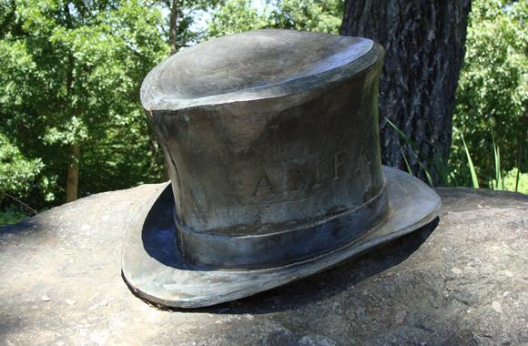 a bronze top hat
