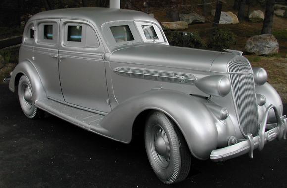 a silver car as a sculpture