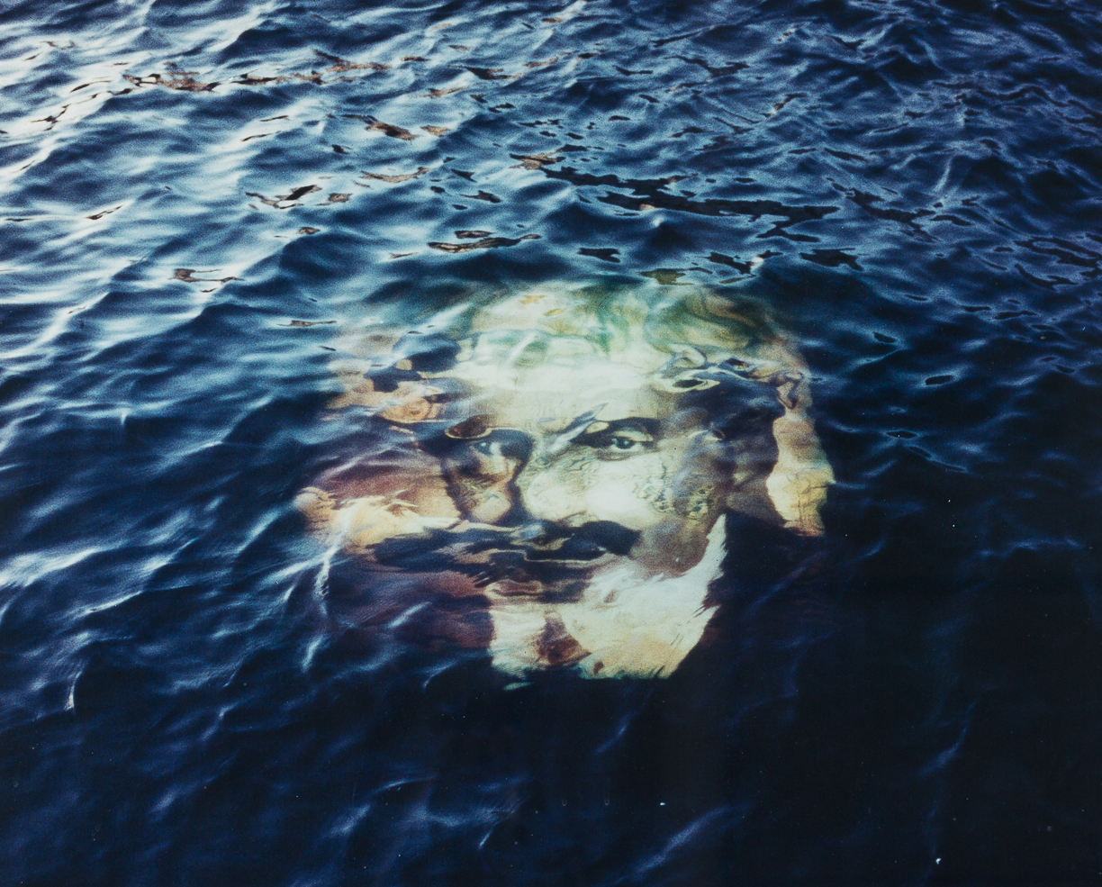 artwork, a mans face in the water