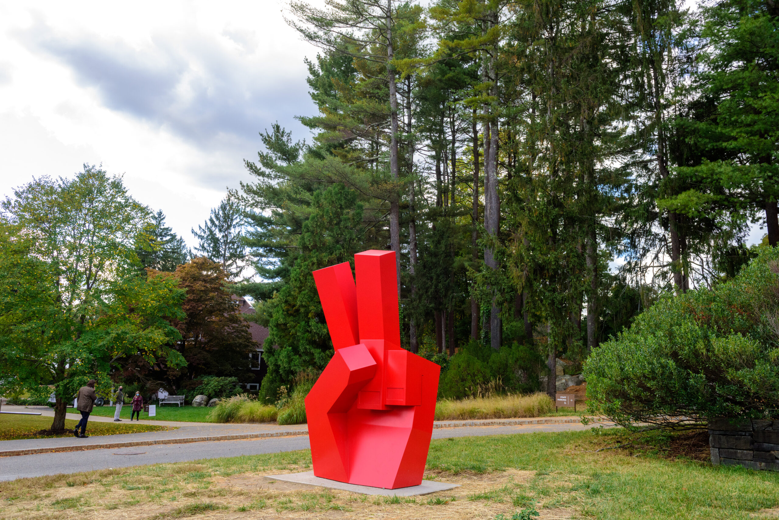 a large bright red hand throws a piece sign in the Sculpture Park