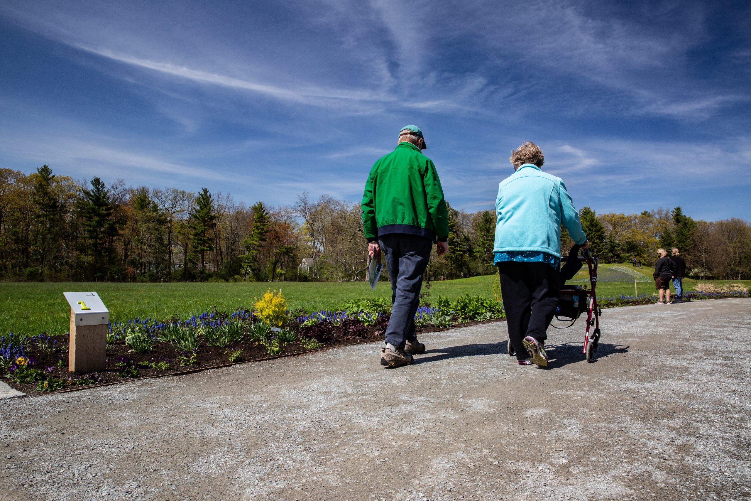 Woman with a walker on the accessible path of the Stevens Coolidge House & Gardens