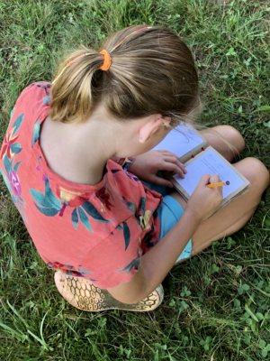 girl nature journaling